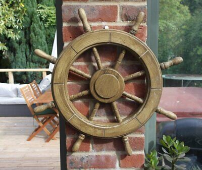 Traditional ship's wooden wheel with wall attachment