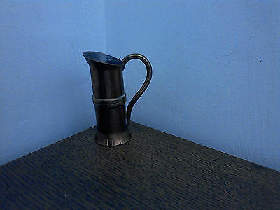 A Lovely Cute Little Copper Jug With Brass Banding And Handle