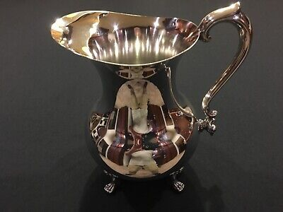 "Beautiful pitcher with ice lip by ""The Sheffield Silver Company"""