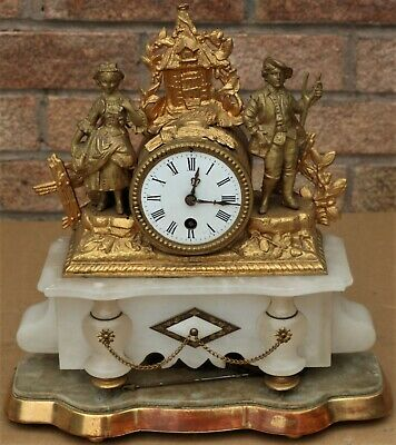 Large Old Gilt Metal Cased Mantel Clock On Base With Man & Woman On It