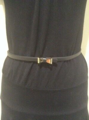 *Women's Black Coloured Belt With A Gold Bow Buckle*