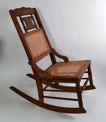 Antique Brown Carved Wooden Rocking Chair With Cane Seat and Back (2293IC)