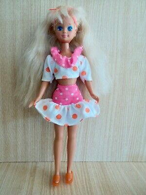 Barbie Sister. 1980's Vintage Stacie in an Orange Spot Skirt & Top.