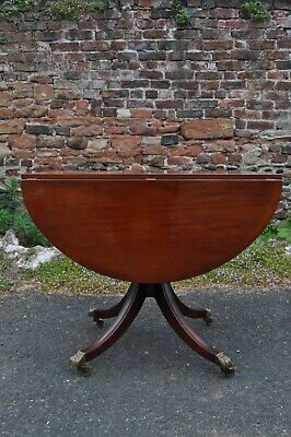 mahogany drop leaf dining table brass claw and ball feet