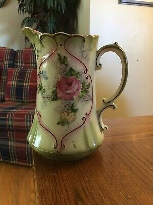 Antique Winton pitcher 1906-1915, chip on spout, cracks under the glaze.