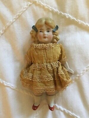 Antique Miniature All Bisque Doll with Sculptured Blonde Hair with Bows