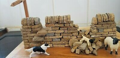 Sheep dog with sheep and stone wall ornament