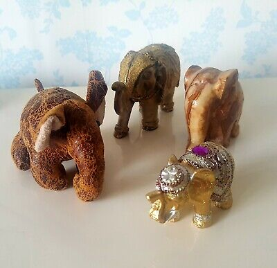 Assortment of 4 assorted elephant ornaments, marble, leather, bronze, gold