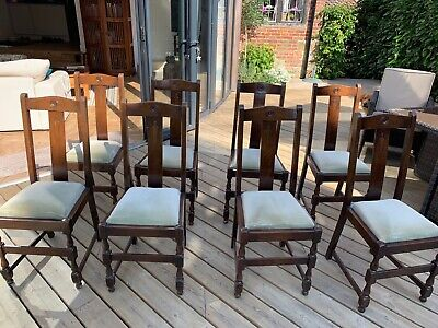 Set of 8 oak 1930s dining room chairs with upholstered seats