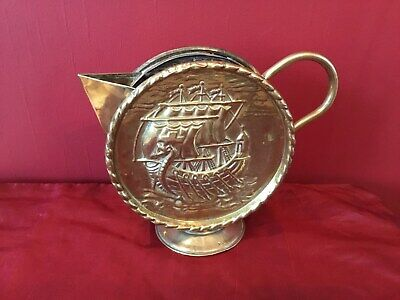 Arts & Crafts Brass repousse work Viking long boat design round sparrow beak jug