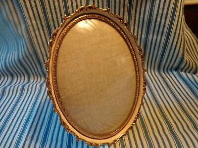 Vtg. Small Metal Oval Picture Frame Gold Tone w Cream Easel Back Convex Glass