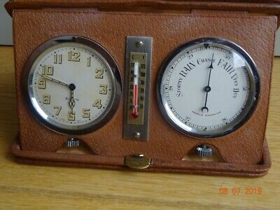 Travel set 8 day watch, barometer and thermometer, housed in leather case, signe