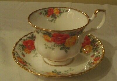 1993-96 ROYAL ALBERT England PACIFIC ROSE  Footed Cup & Saucer Yellow/Rust Roses