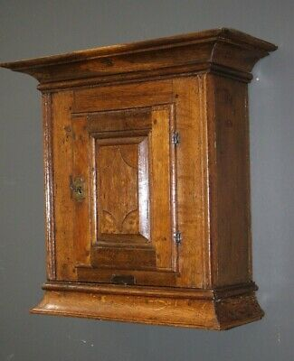 Antique Georgian oak spice cabinet with single panel door secret drawer 1700's