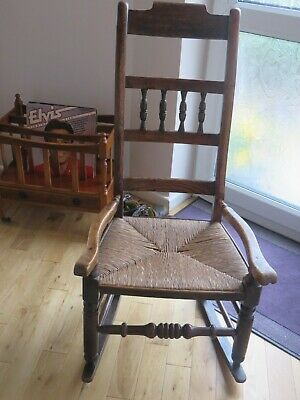 A 19Th Century Elm Rocking Chair With Rush Seat ,In Good Order.