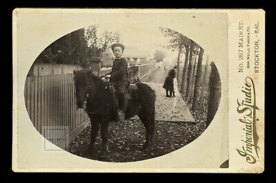 great outdoor street scene id'd boy on horse with note stockton california 1880s
