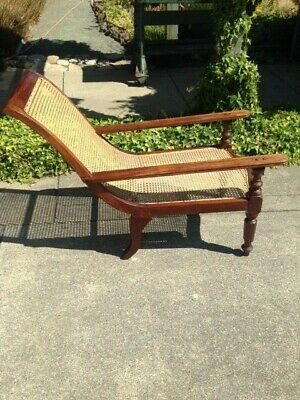 Antique Plantation Caned Arm Chair With Swing Out Foot-Rests