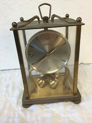Vintage HECO Henry Coehler German Brass Anniversary Clock with 4 Ball Pendulum