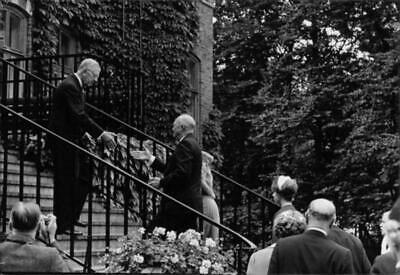 Vintage photograph of Dwight D. Eisenhower receives greeting on the stairs