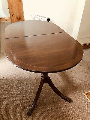 Extending Mahogany dining table and Six chairs