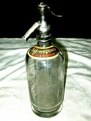 An Early Schweppes Logo Chrome Steel Top 30 fl oz Soda Syphon Bottle with Label