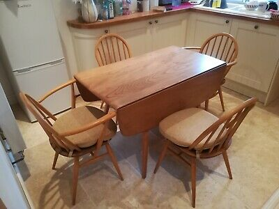 Ercol solid wood extendable/fold down dining table.4 chairs(2 carvers).seat pads