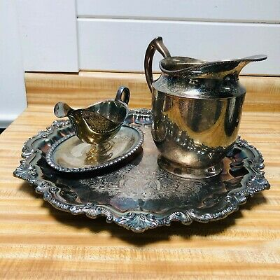 Wallace x-100 silver platter with Poole Silver Co pitcher and Rogers gravy boat