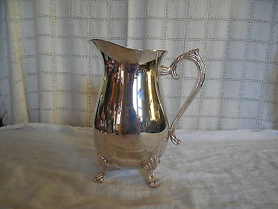 Lovely silver tone claw footed water pitcher E.P. brass