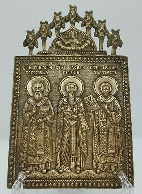 Russian orthodox bronze icon  Three Saints Prelates. With 7 cherubs.
