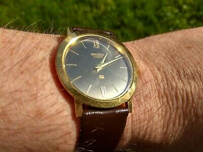 Men's Seiko Black And Gold Tone Watch Brown Leather Band SO-325714