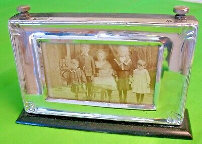 Old antique art deco period silver picture frame on ebononised wooden frame