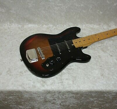 Vintage Harmony solid body electric guitar in sunburst finish with case
