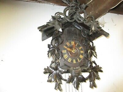 old black forest cuckoo clock musical man and bird
