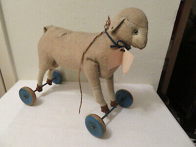 Antique Primitive Wool Sheep Pull Toy Putz? Wooden Wheels Glass Eyes 13""