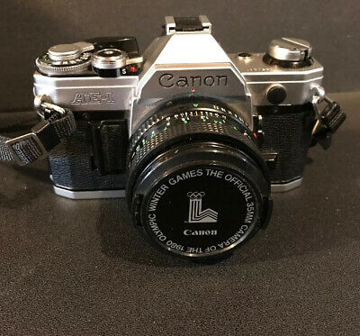 Canon AE-1 Program Camera Outfit with FD 50mm F/1.8 Lens Olympics 1980 Lens Cap