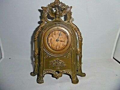 Antique French spelter mantle clock. Open winged eagle, Romanesque