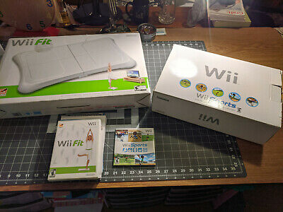 Nintendo Wii white console with Wii Fit and Wii Sports