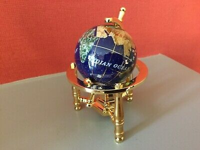 Miniature Gemstone Globe In A Gold Frame.