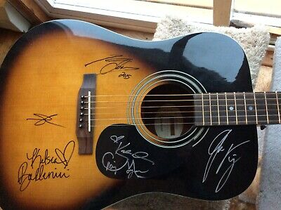 Epiphone 6 string guitar autographed by country celebrates