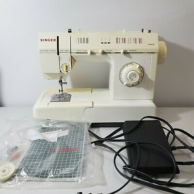 Singer sewing machine 5830c Tested with Pedal & power working.