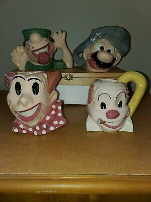 King Features Syndicate. ( K.F.S ) Four face mugs.