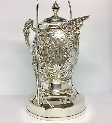 Huge MERIDEN BRITANNIA CO Aesthetic Repousse Silver Plated Tilting Pitcher C1880