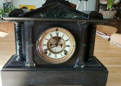 Antique Ansonia Mantel Clock in slate with marble pillars.