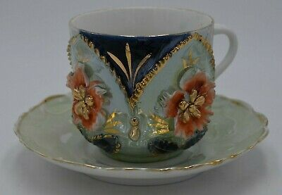 Vintage Porcelain Germany Marked Cup and Saucer Iridescent Floral Gold