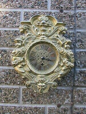 French Gothic Design Ornate Pressed Brass Wall Clock Tic-Tac movement.C1910