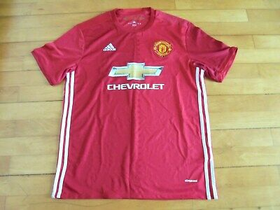 Man Utd Home football shirt size large.