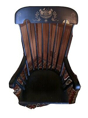 Antique rocking chair beautiful carved wood.