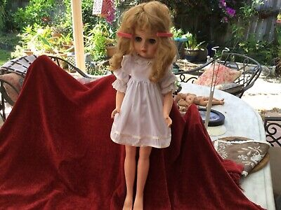 "23"" Vintage doll with long fair hair."
