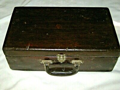 An Old Small Primitive Dark Lacquered Wooden Suitcase