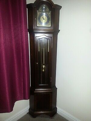 grandfather corner clock.hight 1800mm . Mahogany. in good condition